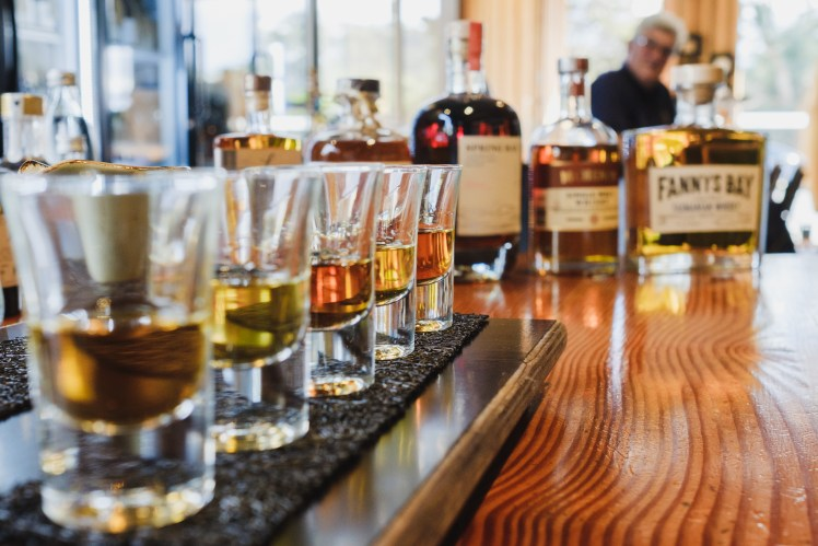 Taste a paddle of fine Tasmanian whiskies at The Farm Shed East Coast Wine Centre