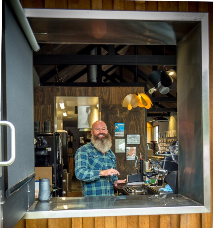 Luke hard at work serving Gather Tasmania espresso coffee from The Farm Shed's coffee window