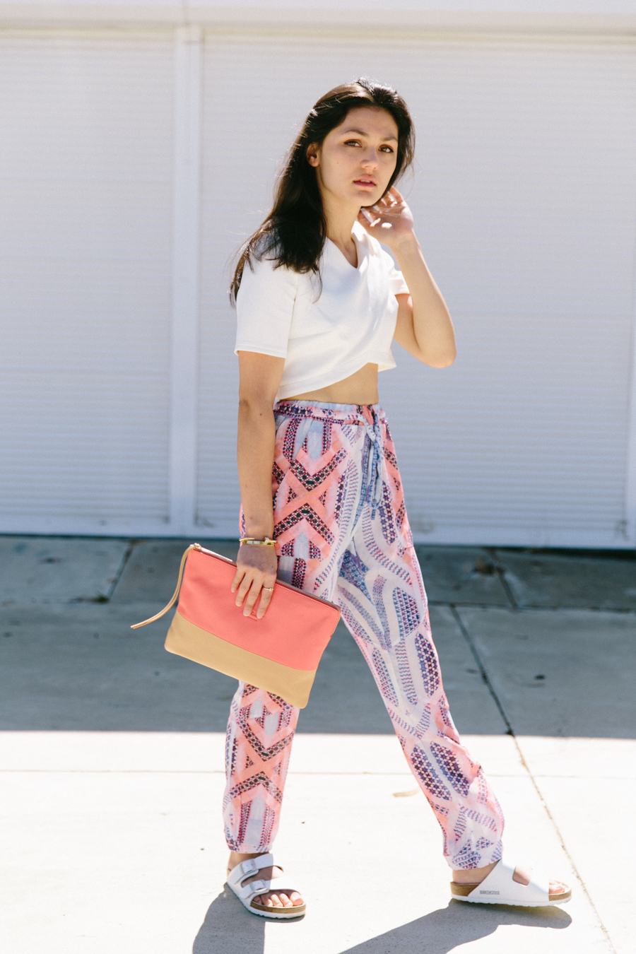 Statement print pants by POL Clothing. Two tone leather clutch from MInskat Copenhagen. White Birkenstock Arizona sandals outfit.