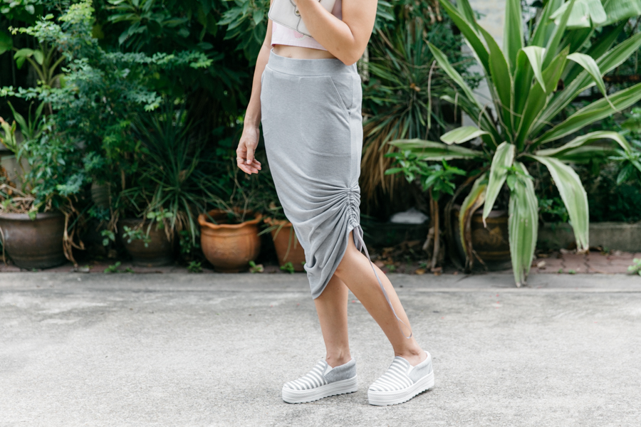 How to wear platform sneakers with a skirt.