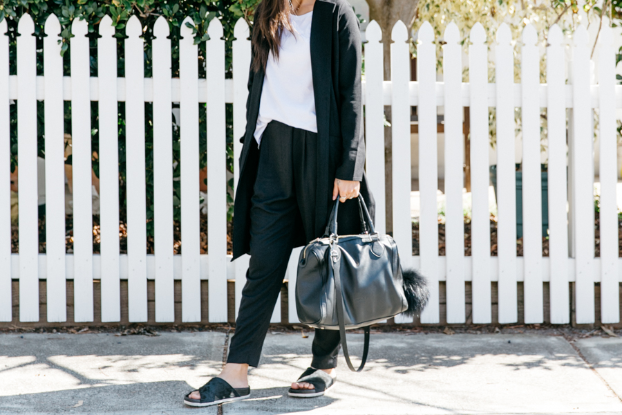 Black draped pants & black leather bag from Minskat Copenhagen.