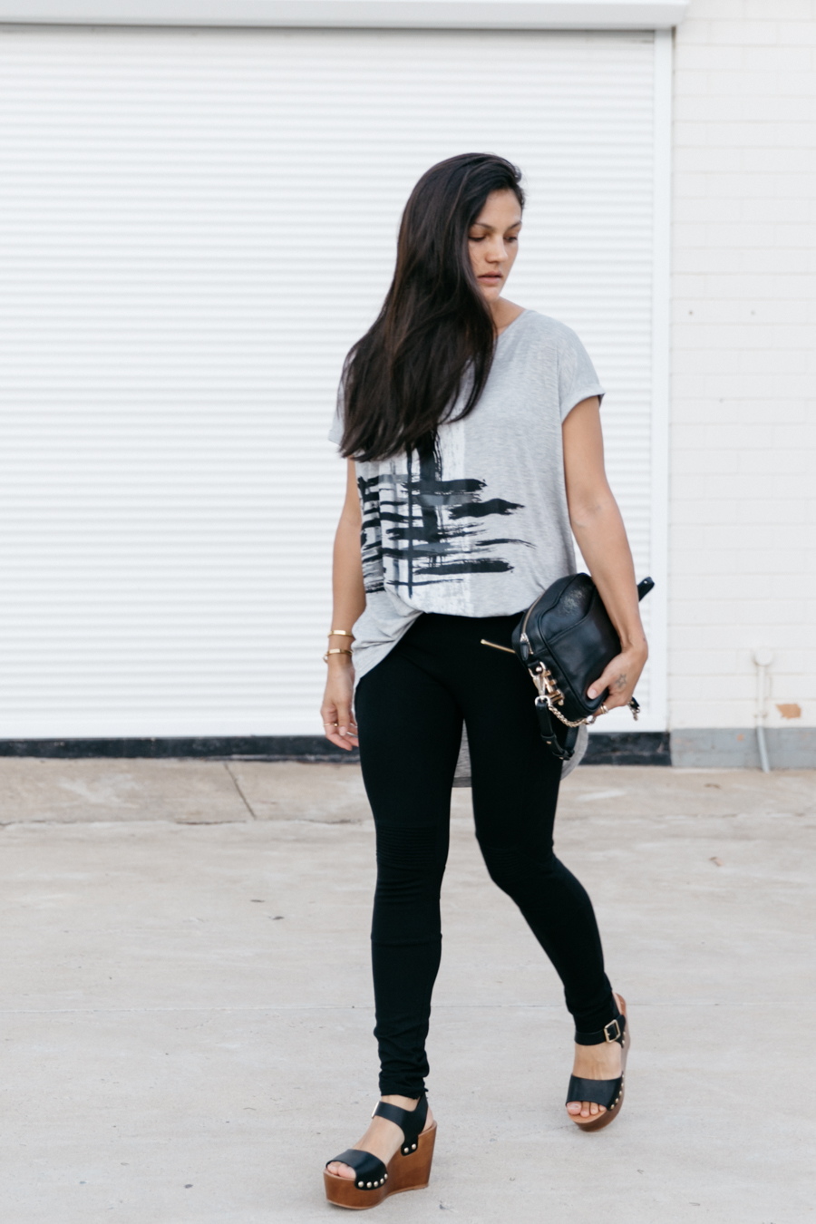 Oversized, long grey top with black treggings.