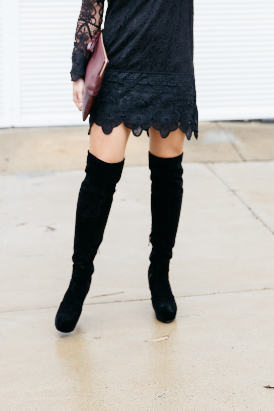 Lace dress with over the knee boots.