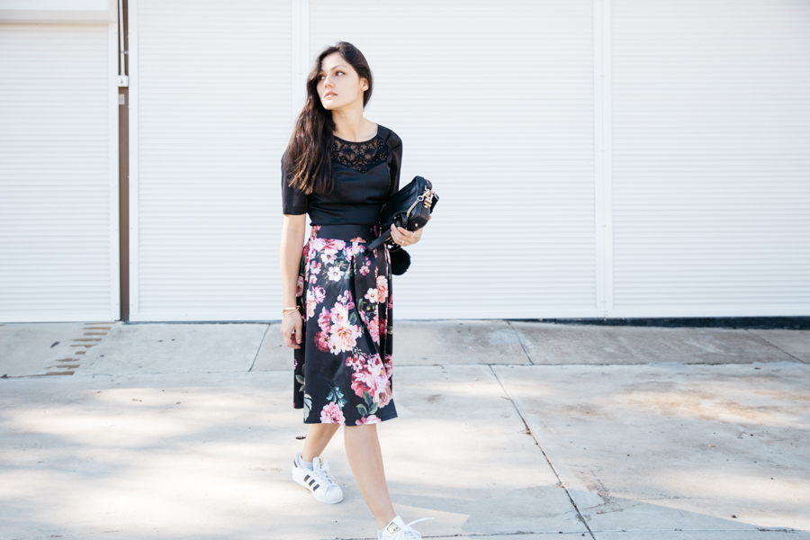 Floral midi skirt with Adidas sneakers.