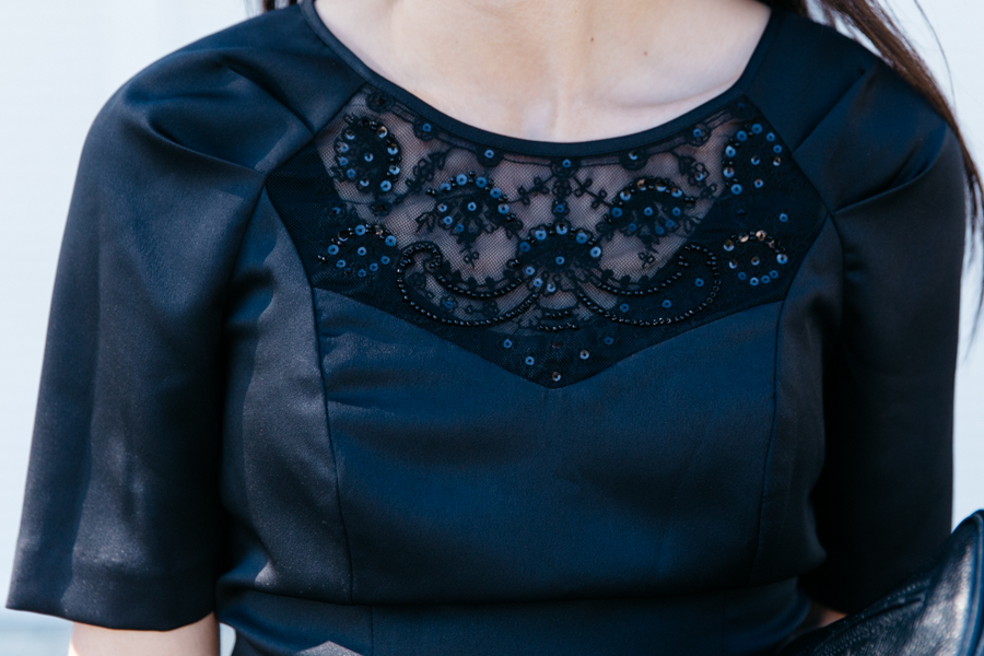 Embellished peplum top.