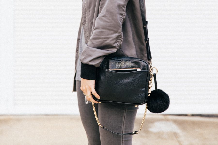 Small black bag with outer pocket.