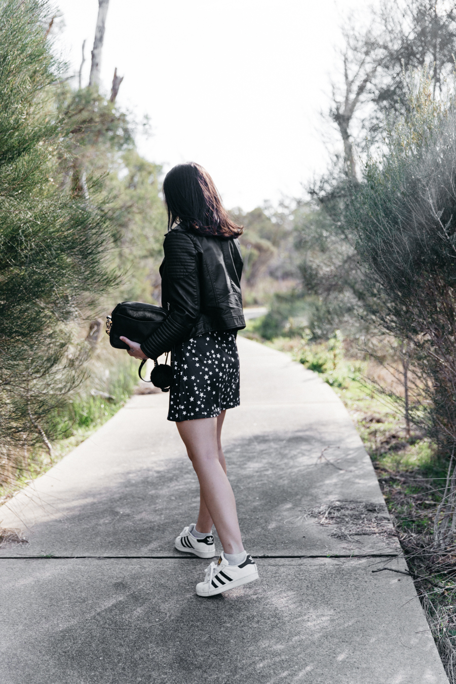 Leather jacket with skater dress outfit.