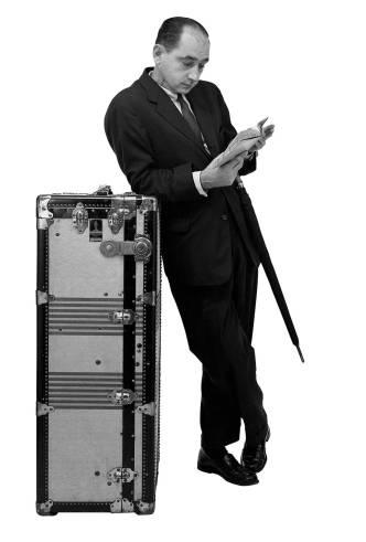 "George Nelson posing for a Herman Miller advert ""Traveling Men"", ca. 1954"