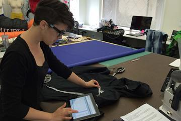 Black Diamond Equipment designer Rachel Metcalf uses a Centric mobile app during a supplier prototype review session.