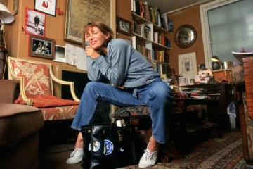 Jane Birkin with the Hermes bag named in her honour, decorated with stickers