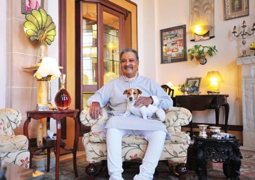 His Highness Maharaja Gaj Singh II of Marwar-Jodhpur in his private quarters at the Umaid Bhawan Palace with one of his beloved Jack Russell terriers and the special blend of Royal Salute created to mark his diamond jubilee