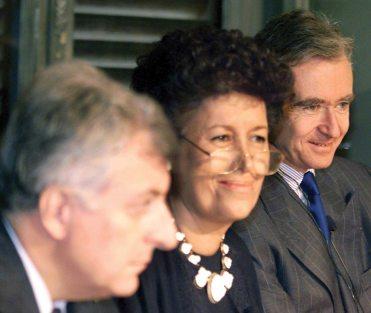 LVMH Bernard Arnault(R), Fendi's President Carla Fendi(C) and the president of Prada Patrizio Bertelli give a press conference in Rome in 1999