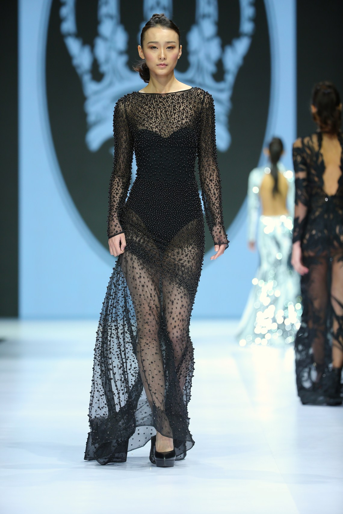 A model wears a design by willfredo gerardo at the mercedes benz fashio week