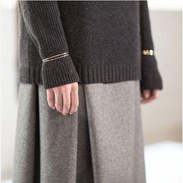 bracelet over sweater