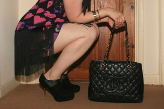 Zara ankle boots, Chanel Shopping Tote, Cartier Love bracelets and Versace for H&M dress
