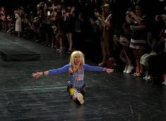 Betsy Johnson doing a split after her collection's showing. That woman is flexible!