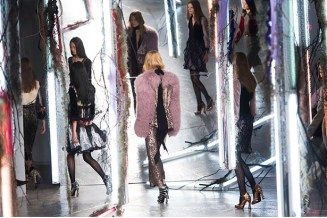 Models walking through the mirrored set for Rodarte