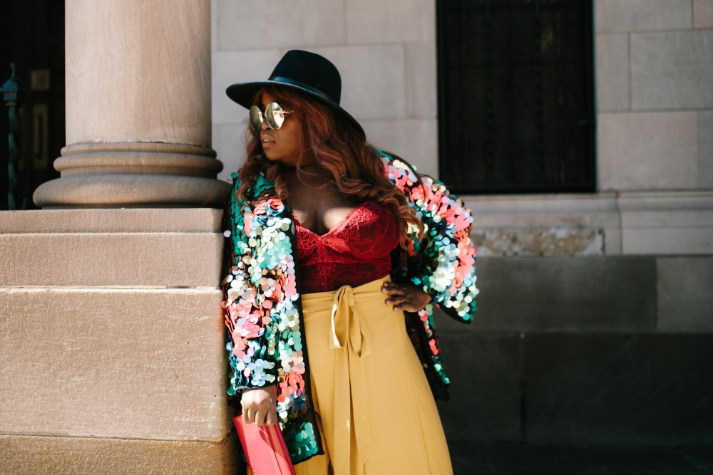 INCLUSION RIDERS Black Chicago plus size blogger of color wearing red & yellow and sequins
