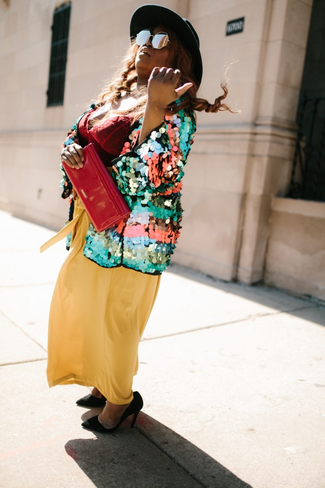 INCLUSION RIDERS Black Chicago plus size blogger of color wearing yellow pants with sequins jacket