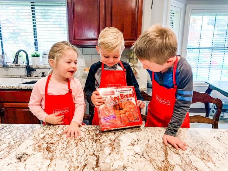 Kids holding a box of frozen Monkey Bread