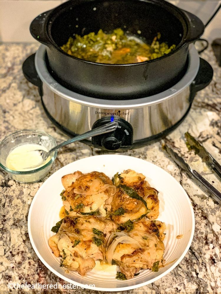 close up of smothered chicken recipe with the Pampered Chef RockCrock in the background