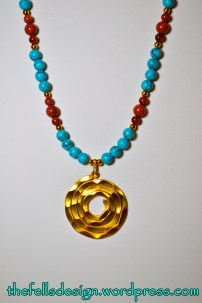 Turquoise and goldstone necklace with repurposed gold spiral