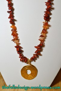 Red and orange gemstones with repurposed gold pendant
