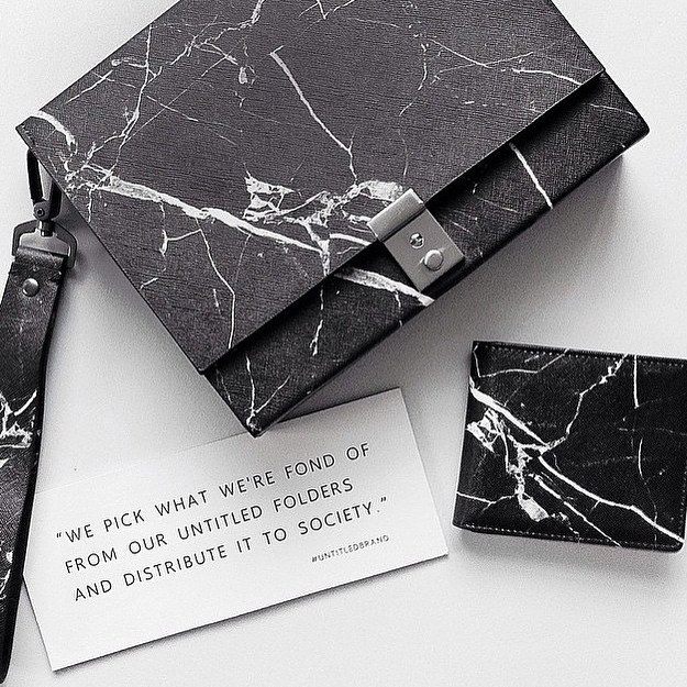 untitled brand marble inspired bag with chain straps