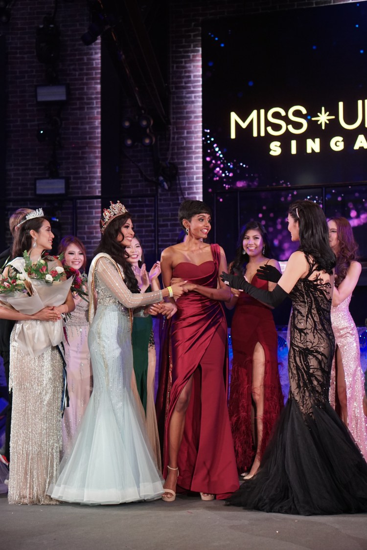 Mohana in shocked receiving after being announced as Miss Universe Singapore 2019 and receiving a hug