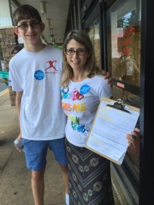 The FeMOMist and her 16 year old son registering voters in Falls Church, VA.