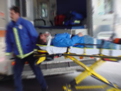 Personal Injury Victim being helped by medical team