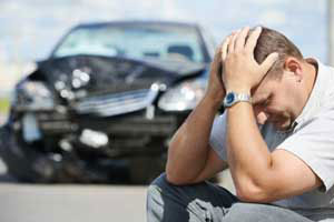 Image of an upset person after an auto accident