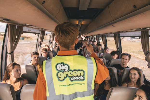 Big Green Coach Volunteers talking to passengers