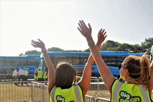 Big Green Coach Volunteers waving goodbye