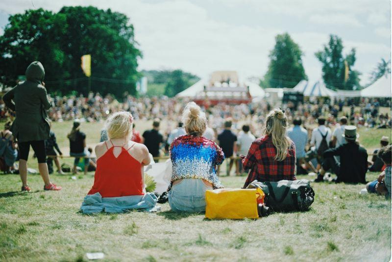Music Festival people sat in field