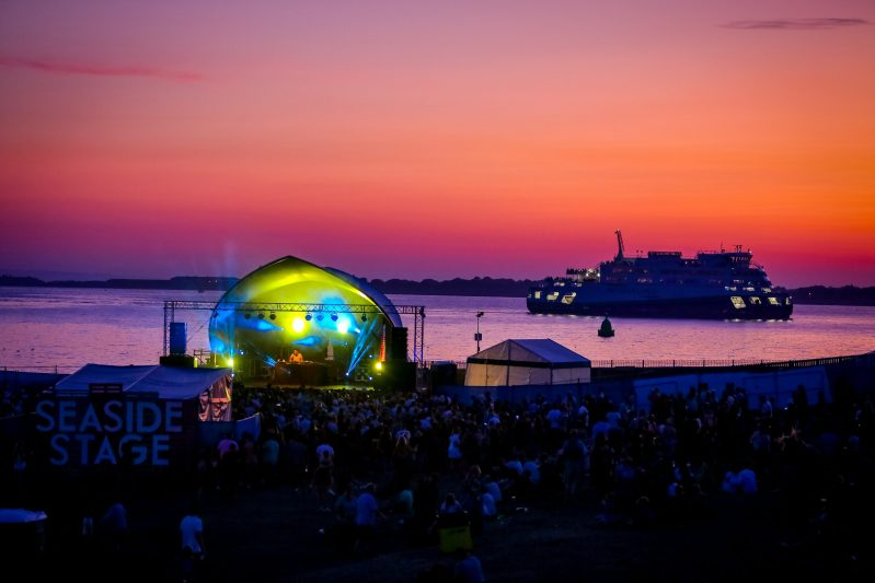 Victorious Festival seaside stage ferry sunset