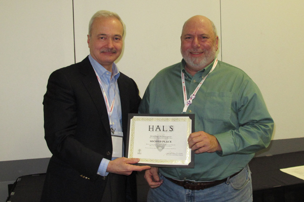 Second place winner Douglas Nelson accepting the award from Paul Dolinsky, Chief of HALS. image: Chris Stevens