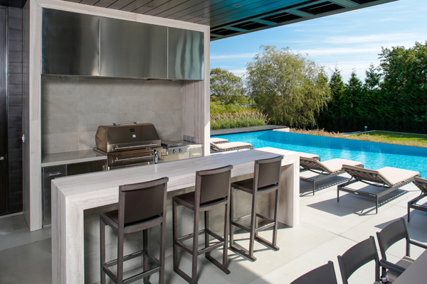 The type and variety of kitchen equipment depends on the client's needs, but planning should account for refrigeration, cook surfaces, serving areas, sinks, lighting, storage, and trash disposal in a layout that is practical and aesthetically pleasing. image: Kalamazoo Outdoor Gourmet