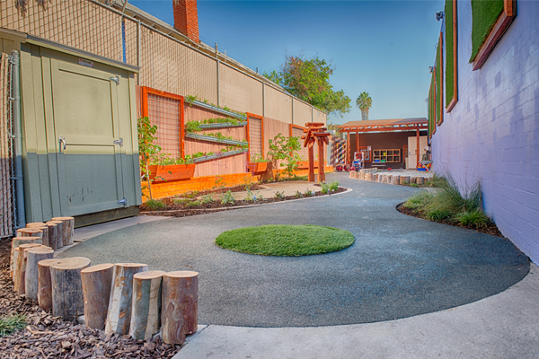 After. View looking North. The periwinkle wall helps to soften the building and reduce sun reflection while creating a calming atmosphere for the children. image: Alex Calegari