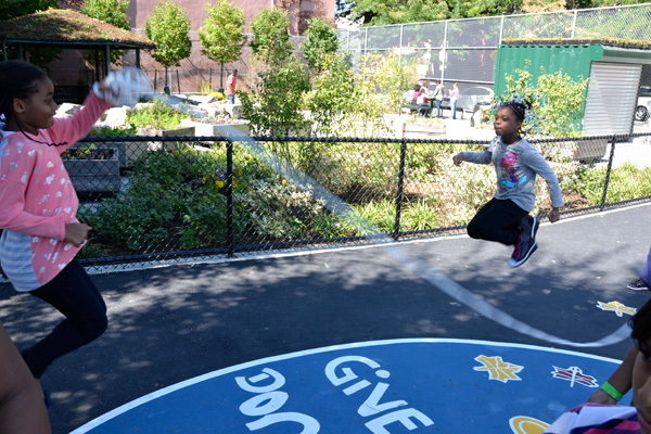 PS 261: children playing with the new rain garden and gazebo in the background. image: Pedro Diez