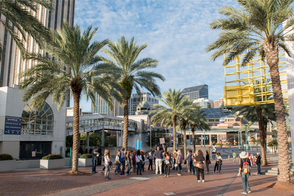 Continuing toward Woldenberg Park and the French Quarter on the Riverwalk, the WILA Walk stopped in the Audubon Aquarium of the Americas Plaza. image: Event Photography of North America Corporation (EPNAC)