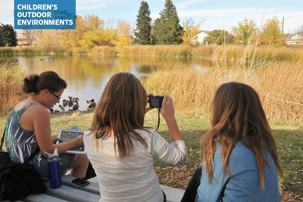 Middle school students documenting a site with photos