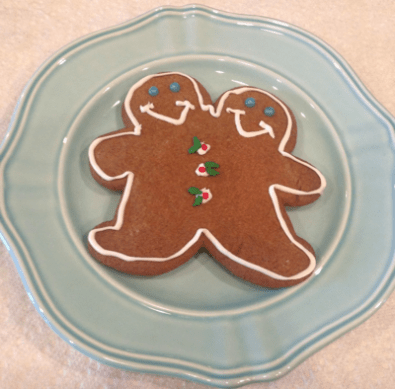Conjoined Gingerbreadmen made with cookie cutter from the Mutter Museum depicting those guys to the left.