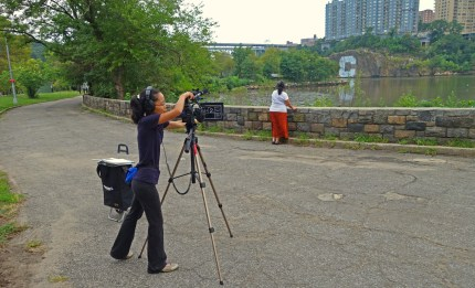 Director Phyllis Yip operates the camera for a scene with actors Mayra Fernández and Johanna Martinez (off screen).