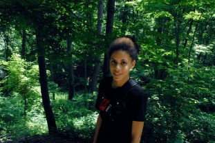 Associate Producer Sophia Tewa looks for a spot for a scene in the woods.