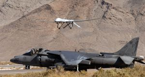 Predator drone landing. Incidentally, the other aircraft's design was stolen and copied by the Soviets. Image: DOD