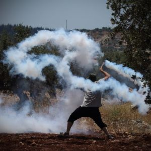 """Tear gas grenade returned to soldiers using sling"" by Yaron Ben-haim"