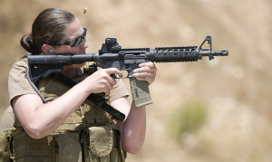 """""""US Navy 100714-N-4965F-174 Chief Mass Communication Specialist Paula Ludwick, assigned to Fleet Combat Camera Group Pacific, shoots at a target during a Navy Rifle Qualification Course"""" by U.S. Navy photo by Mass Communication Specialist 1st Class James Foehl"""