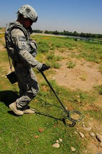 US soldier searching for weapons caches in Iraq. Image Source: SSgt. Edward A. Reagan