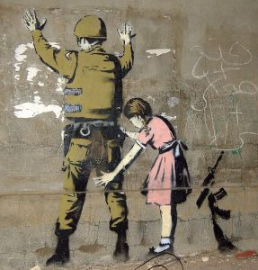 "An image in Palestine.  Image Source: ""Bethlehem Wall Graffiti 1"" by Photo: Pawel Ryszawa, Graffiti: Banksy - Own work."